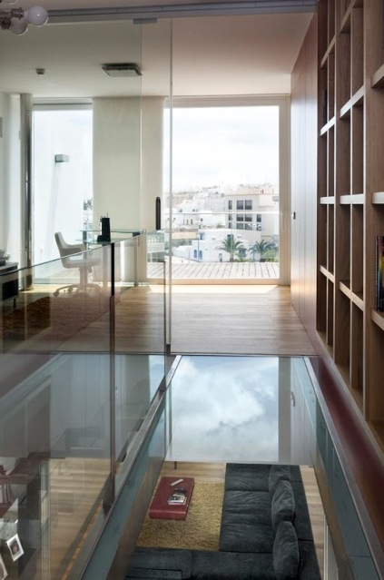 catwalk library over the living area